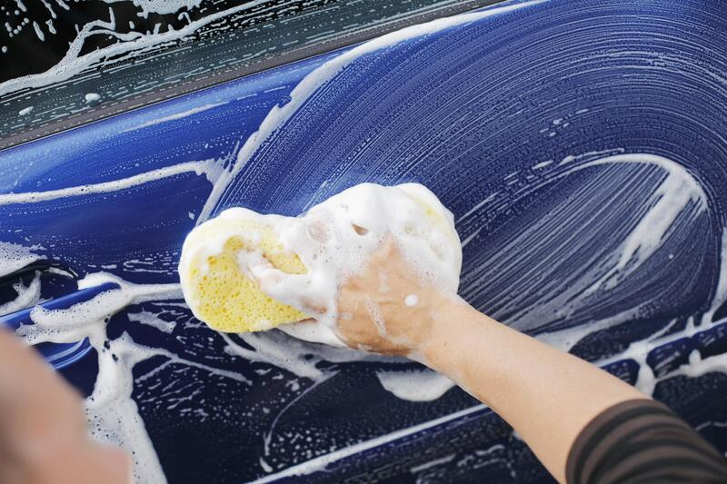 professional auto detailing expert working on exterior wash