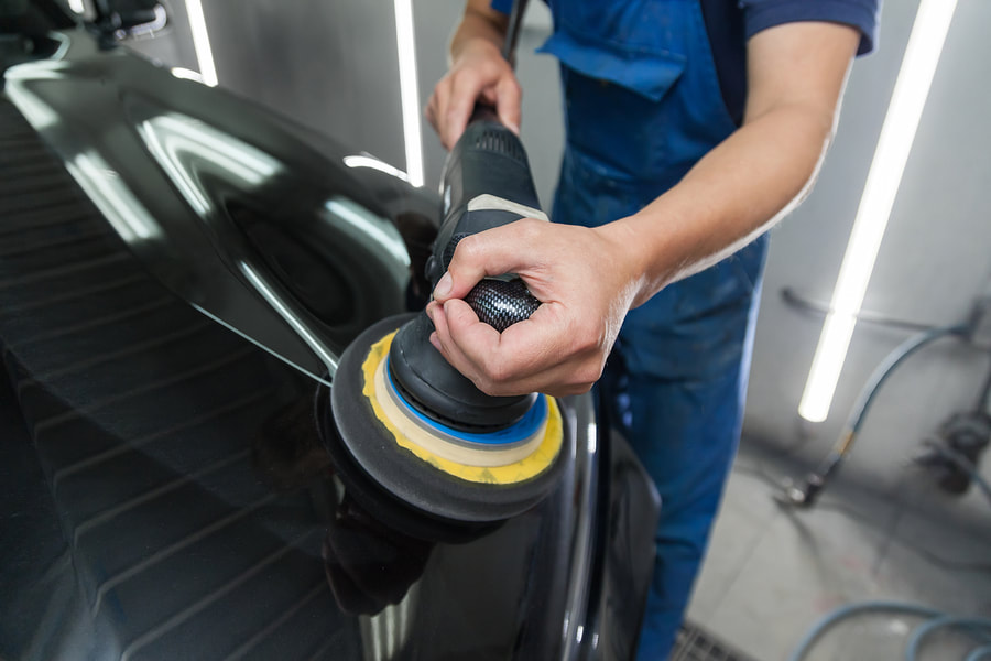 professional auto detailing expert working on exterior detailing