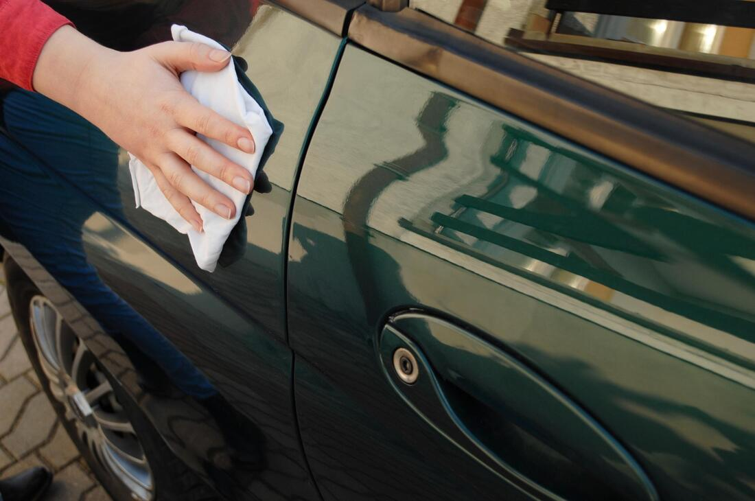 professional auto detailing expert working on paint correction