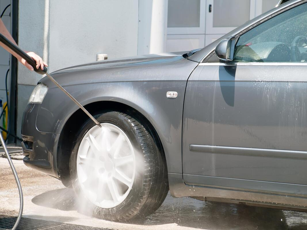 professional auto detailing expert working on tire and wheel detailing