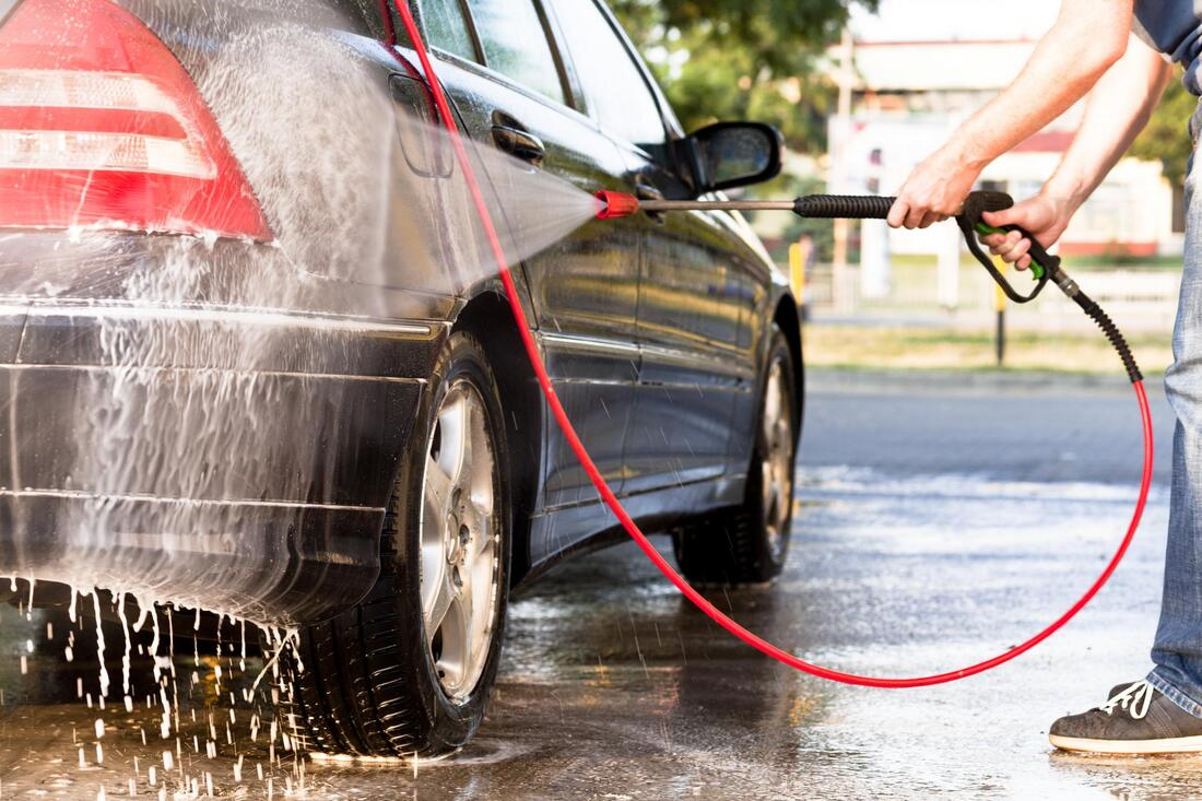 professional auto detailing expert working on pressure car wash
